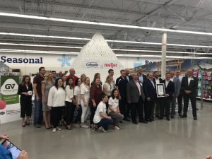 the crew at Kimberly-Clark Corporation, Cottonelle, and Meijer after breaking the world record for the tallest pyramid of toilet paper