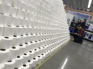 measuring the base of the world's tallest pyramid of toilet paper