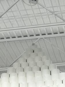 target at top of world's tallest toilet paper pyramid