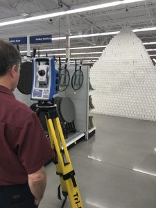 measuring the world's tallest pyramid of toilet paper